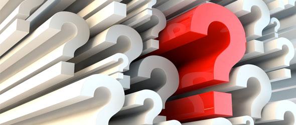 Des points d'interrogation de différentes tailles et formes rendus en trois dimensions.